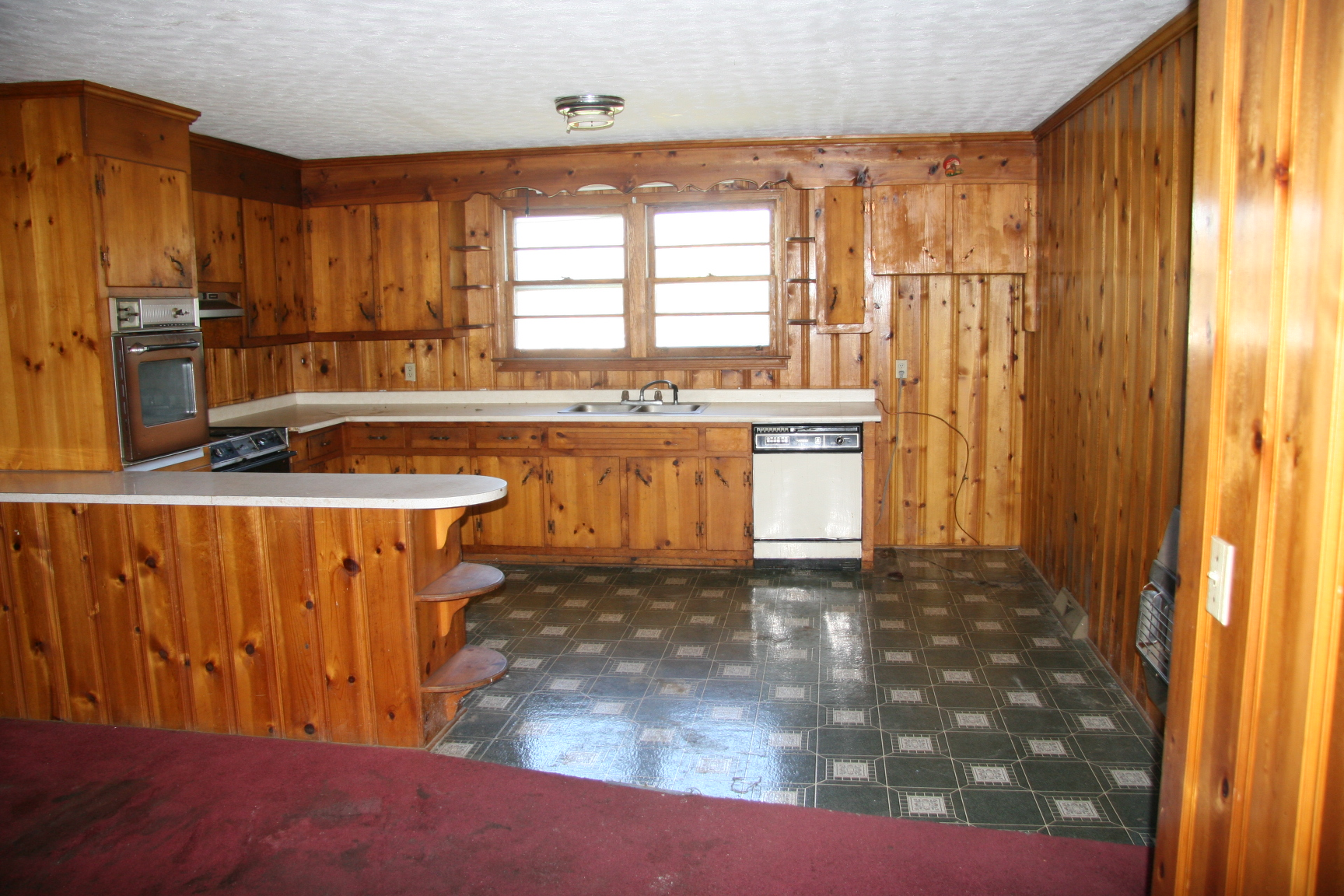 Bank ordered auction brick ranch in north greenville for Auctions for kitchen cabinets